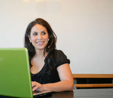 Pretty customer service rep with headset phone and laptop Stock Photo