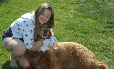 well loved: teen girl hugging big red dog  1 Stock Photo