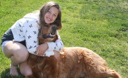 teen girl hugging big red dog  2 Stock Photo - 15340356