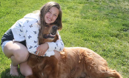 well loved: teen girl hugging big red dog  2