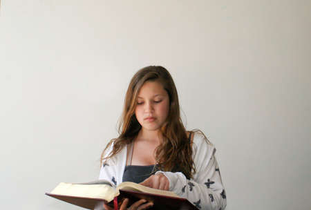 Teen girl reading bible Stock Photo - 15340338