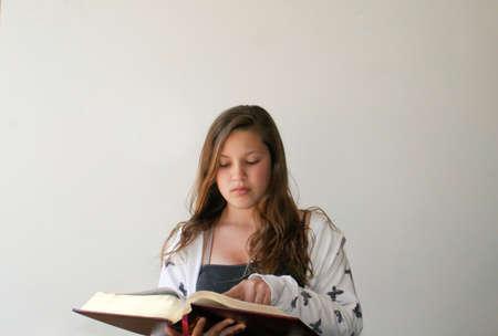 Teen girl reading bible Stock Photo - 15340338