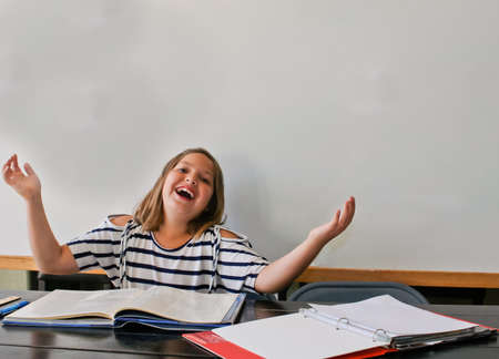 triumphant teen doing homework Stock Photo - 15340346
