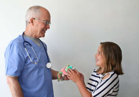 Dr  giving gift to young patient Stock Photo