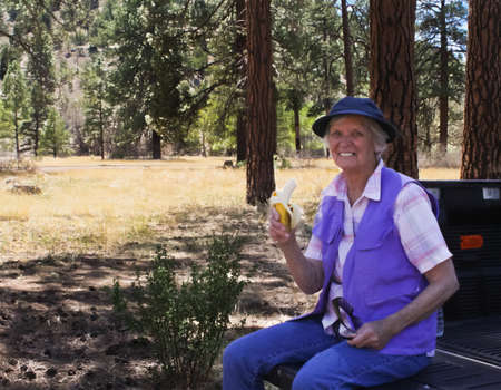 Octogenarian woman enjoying natural forest  Stock Photo