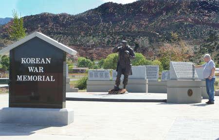 Old soldier remembering fallen friends at Korean War Memorial, Cedar City Utah