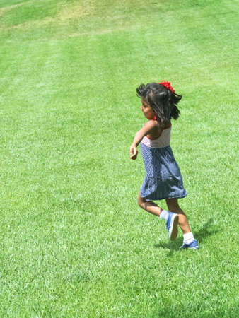 happy young hispanic girl running in park Stock Photo - 15340530