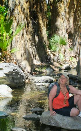 Boomer woman enjoying desert oasis
