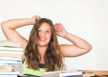 Happy female teen with arms up to celebrate homework done photo