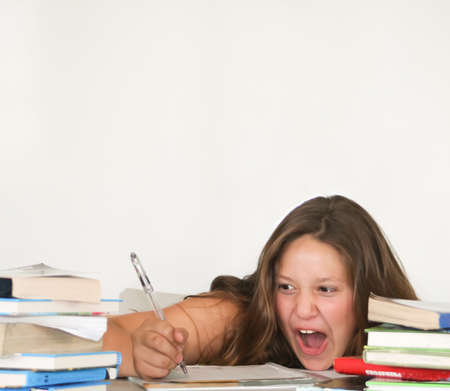 Pretty teenage girl screaming happily while studying Stock Photo - 15243506