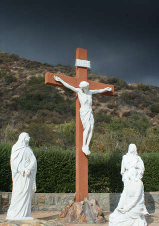 Three life-sized crucifixion statues against very dark sky, Stock Photo