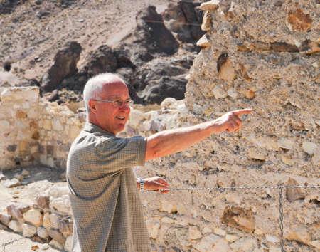 Senior exploring gold rush ruins in Ryolite, NV photo