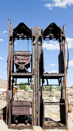 gold and silver double ore car stacking mine shaft lift Stock Photo