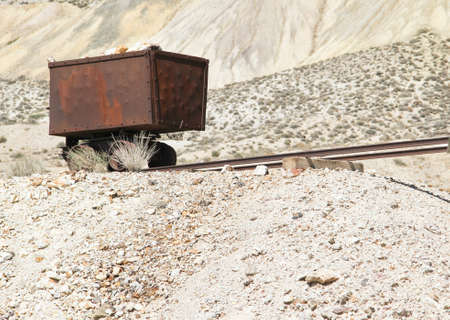 red rusted vintage gold and silver ore cart abandoned in Nevada desert