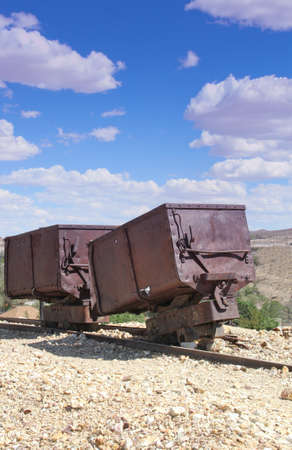 two red rusted vintage gold silver ore cart abandoned in Nevada desert Stock Photo