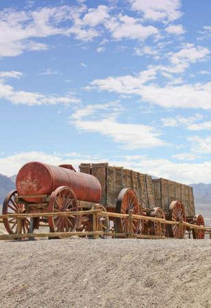 Vintage 1900 wooden Borax wagons pulled by twenty mule teams in Death Valley