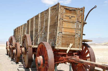 Vintage 1900 wooden Borax wagons pulled by twenty mule teams in Death Valley photo
