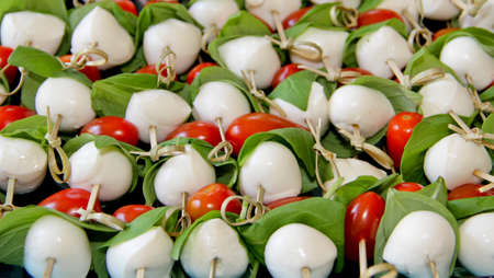 plate of skewered mozzarella balls with tomatoes  and basil Stock Photo