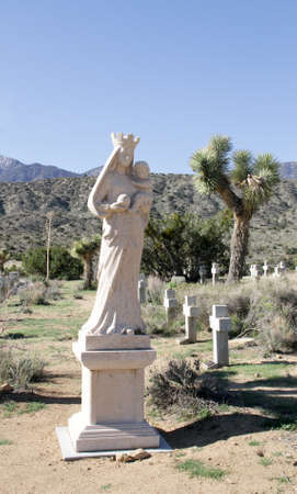 Mother Mary Statue in Desert Cemetery Stock Photo