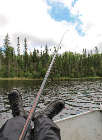 Retired army fisherman foot view Stock Photo