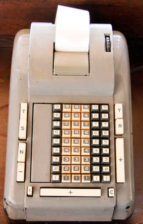 antique 60 key electric adding machine with paper tape Stock Photo