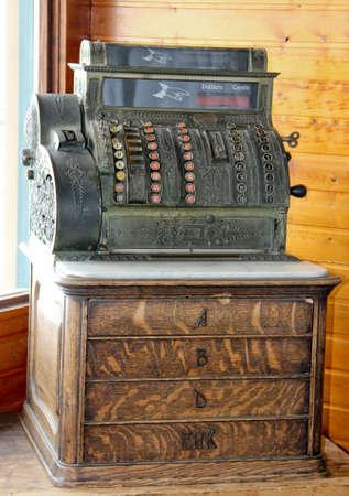 Vintage c 1900 non-branded brass NCR four drawer cash register on wood base