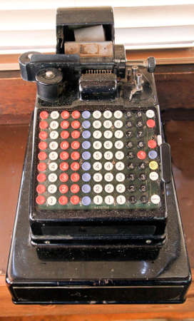 antique 90 key electric adding machine with paper tape Editorial