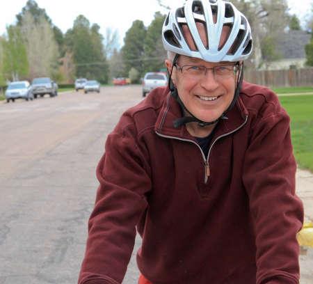 Senior male on racing bike
