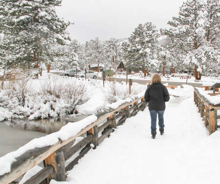 Senior female on snowy park trail