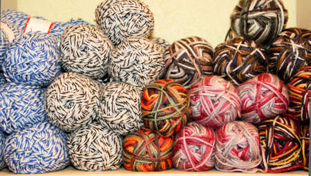 variegated yarn skeins stacked on display for sale Stock Photo
