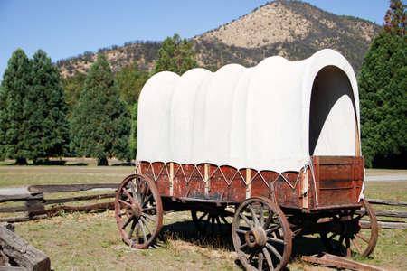 vintage original restored white canvas, wooden covered wagon