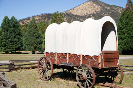 vintage original restored white canvas, wooden covered wagon