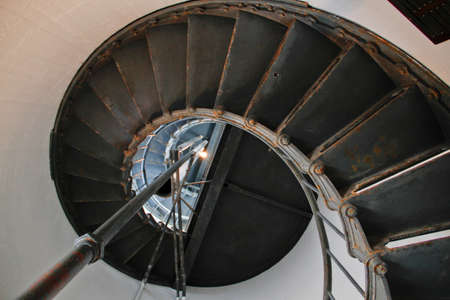 steel metal stairs in Point Arena lighthouse viewed from bottom