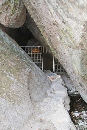Steel bars blocking entry to underground caves