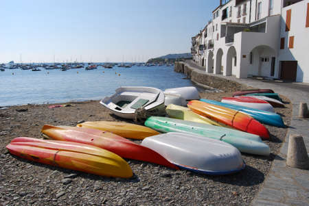Canoes in the beach  Cadaques, Spain  photo