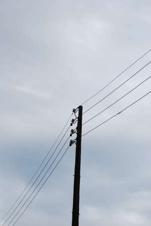 utility pole: Utility pole with four wires