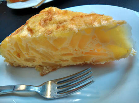 an omelette: Spanish omelette on a plate