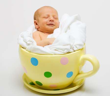 spot the difference: baby in cup Stock Photo