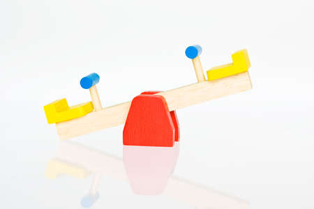 unequal: seesaw its all about balance Stock Photo