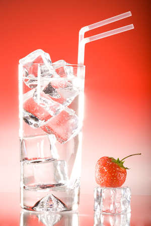 Tall iced drink with strawberry and strawberry lighting photo
