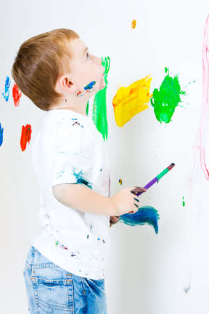 Three year old boy reviewing his painted wall photo
