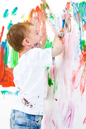 Three year old boy having a lot of fun painting a wall Stock Photo - 3361798
