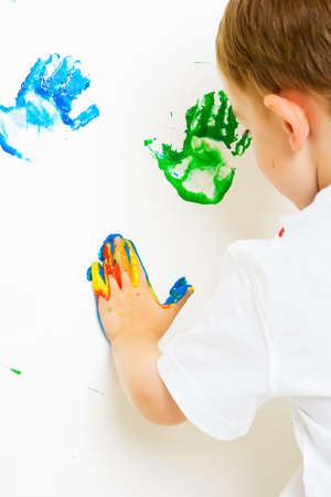 Painted hand prints on the wall Stock Photo - 3361744