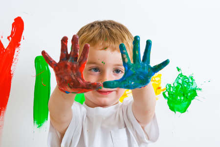 painted hands: Boy with painted hands