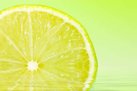 sweet segments: Slice of lime with water reflection