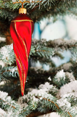 twisty: Red twisty Christmas icicle on a snowy tree