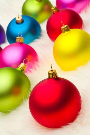 crimson colour: Christmas baubles on white fur Stock Photo