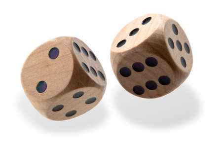 tumbling: Two isolated wooden dice tumbling with black spots