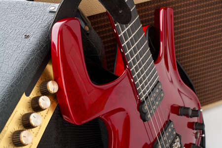 Red electric guitar and two amps