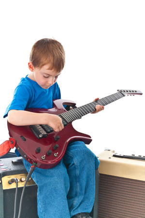 five year old rockstar playing his guitar Stock Photo - 7054243